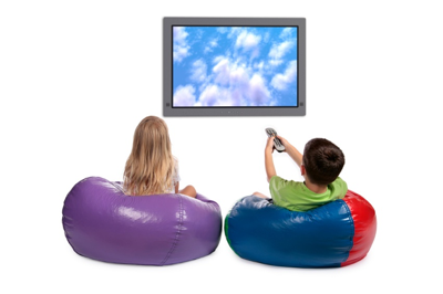 Photo of a young girl and boy watching a large screen television.